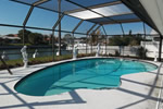 Enjoy a swim in the screened pool